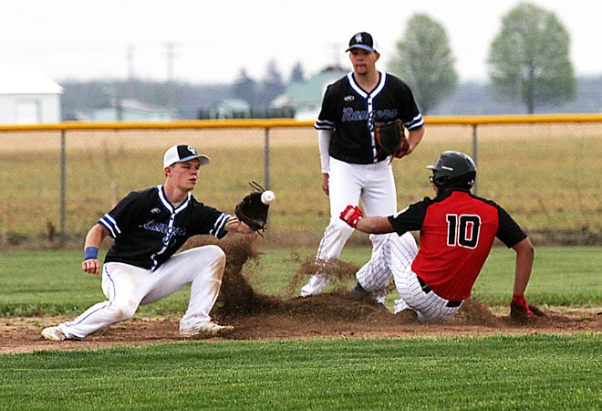 Esteban Castro of White Pigeon slides safely into second base on a steal attempt against Cassopolis on Monday.