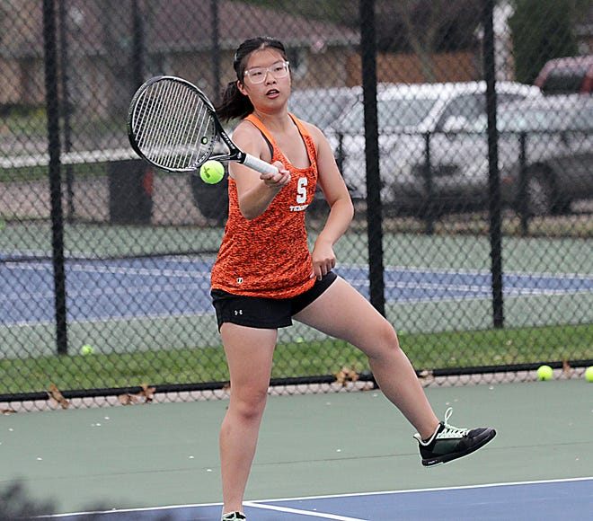 Amy Chen hits a return shot in her match at second singles on Monday afternoon.