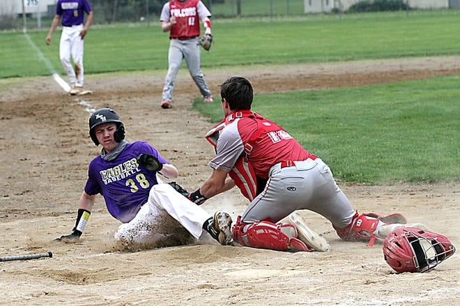 Constantine catcher Jacob Derda tags out a Schoolcraft base runner at home in prep baseball action on Monday.