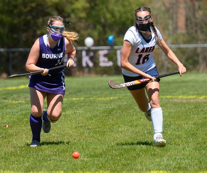 Bourne's Holly Miller and Apponequet's Viktoria Harte race for a loose ball.