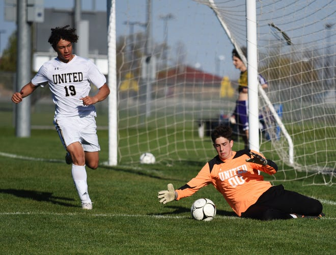 Central Iowa United keeper Tanner Scroggins comes up to make a save during CIU's 10-0 loss to No. 4 Nevada April 29 at the SCORE Athletic Complex in Nevada.