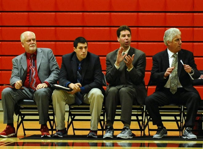 The late Pat Oroszko, second from right, shown. in 2016 cheering on the Clark men's basketball team from the bench as an assistant coach.