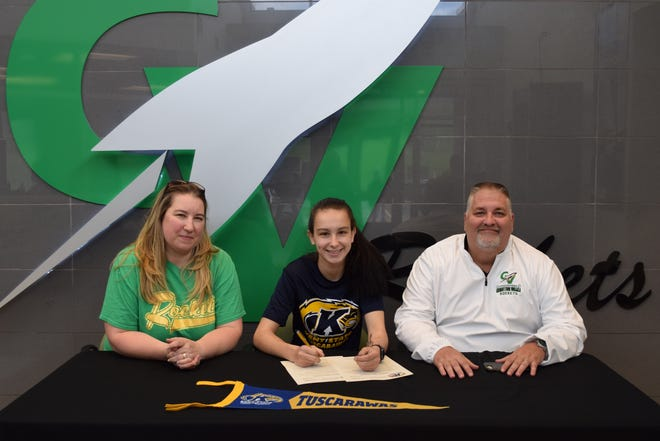 Signing a letter of Intent is Autumn Brown seated between her mother Julie Herman and her stepfather Todd Herman.
