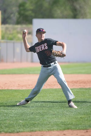 La Junta High School's Trevor Johnston throws to first after fielding a ground ball at third base during the non-league matchup with Central on Tuesday May 4, 2021 at Andenucio Field.