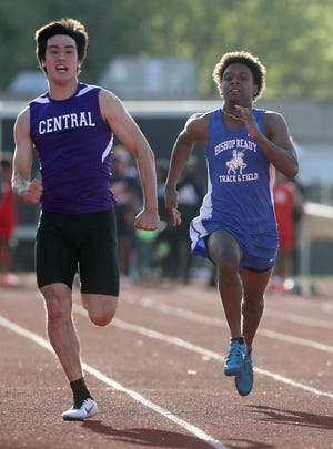 Ready's Tyrese Hudson (right) and Pickerington Central's Samuel Mba compete in the 100 meters during the Pat McMillin Invitational on April 16 at Whitehall. Hudson has been one of the Silver Knights' top sprinters this season.