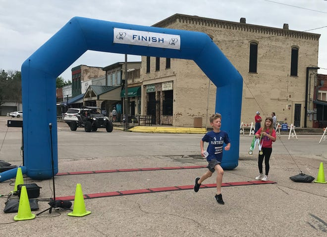 Tyson Hennigan outran the entire field to finish an easy first in the Little Big Town Fun Run