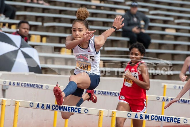 Life Waxahachie's Bre'anna Lacy runs the 300 hurdles during the Class 4A Region II meet at Texas A&M-Commerce two weeks ago. Lacy and other Life teammates will be headed to Austin on Thursday to battle for medals at the University Interscholastic League state championships.