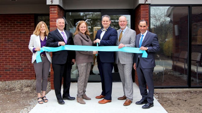 Colleagues from South Shore Health and Aspire Health Alliance gather for a ribbon cutting ceremony outside of 797 Main St., Weymouth. From left: Christine Just, executive director, Behavioral Health, South Shore Health; Timothy Quigley, senior vice president, chief nursing officer, South Shore Health; Julie Paul, director, Perinatal Behavioral Health Program, South Shore Health; Todd Kerensky, director, Addiction Medicine Services, South Shore Health; Antony Sheehan, president and CEO, Aspire Health Alliance; and Allen L. Smith, president and CEO, South Shore Health.