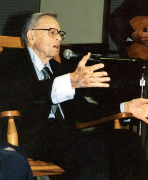 """In this Town Talk photo from 1999, former Gov. Jimmie Davis leads the crowd in singing """"You Are My Sunshine"""" at a Louisiana College symposium held in his honor in 1999. Davis wrote the song in 1940.  Davis died in 2000."""