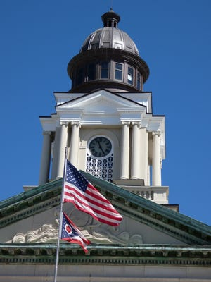 The U.S. and Ohio flags fly in front of the Crawford County Courthouse.