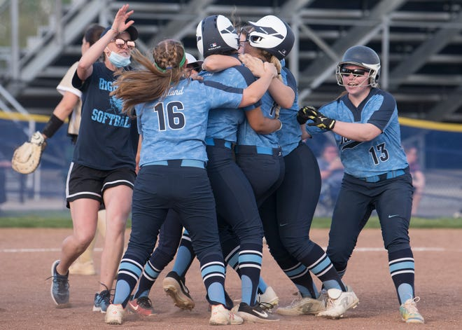 Highland's softball coach Jamie Minix, left, celebrates with her players after Highland defeated Deptford, 8-7, at Highland Regional High School on Tuesday, May 4, 2021.