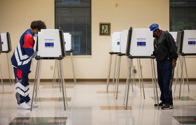 Voters cast their votes at the Urban League of Cincinnati in Avondale, May 4, 2021. The May primary included the Cincinnati mayoral race, along with Issue 3.