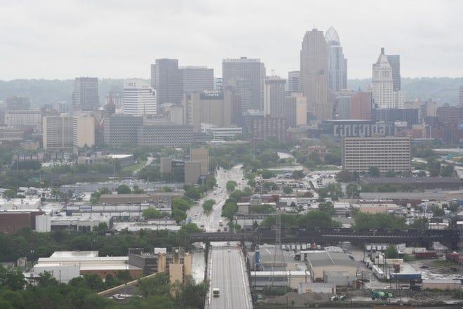 A foggy downtown Cincinnati skyline in-between rain showers, Tuesday, May 4, 2021 at Olden View Park in Cincinnati, Ohio.