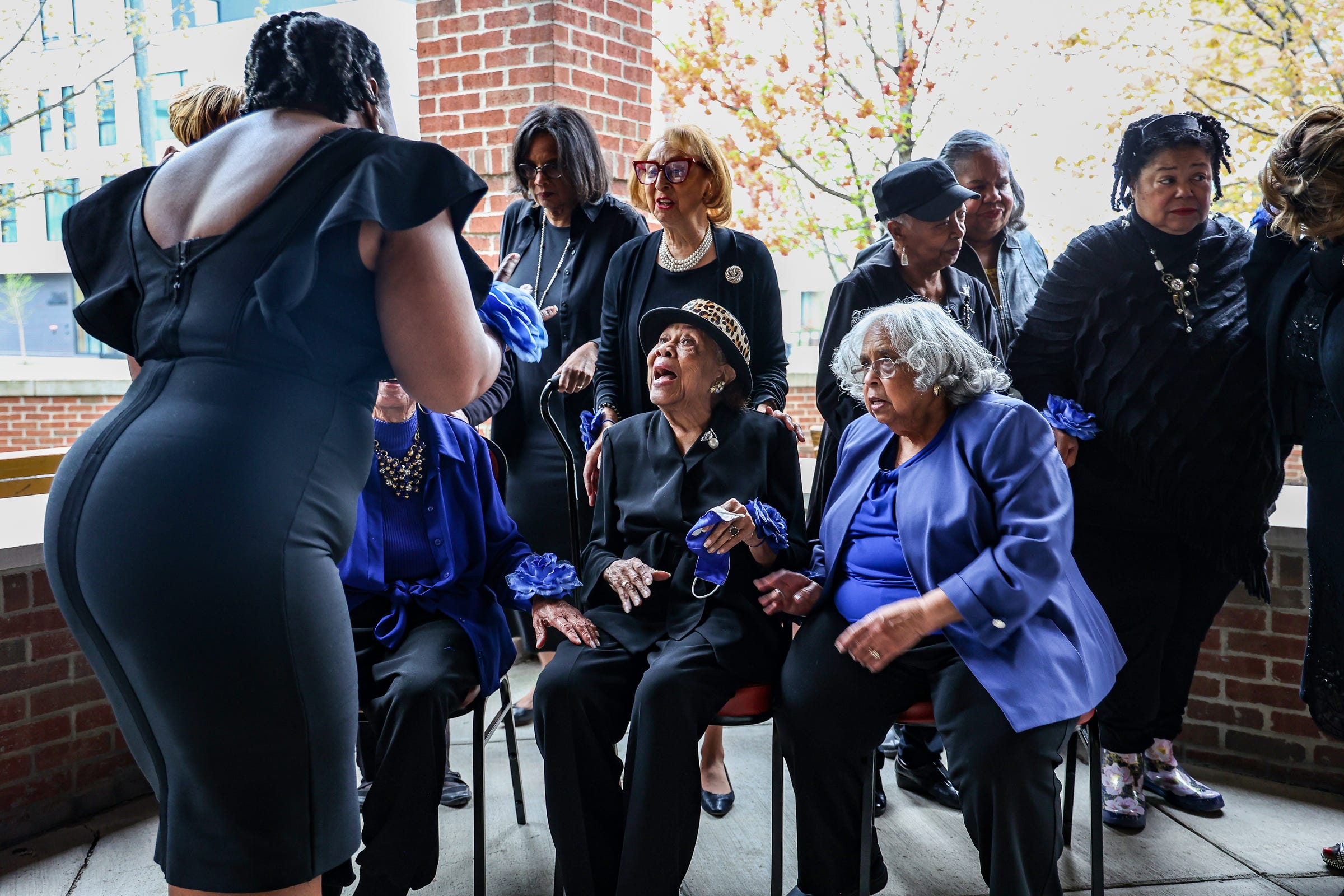 Members of the Elliottorian Business and Professional Women's Club mingle after posing for a photo at the Village of Brush Park Manor Paradise Valley in Detroit on April 29, 2021.  The Elliottorian Business and Professional Women's Club is the first club of Black business women in Detroit and Michigan and was founded in 1928.
