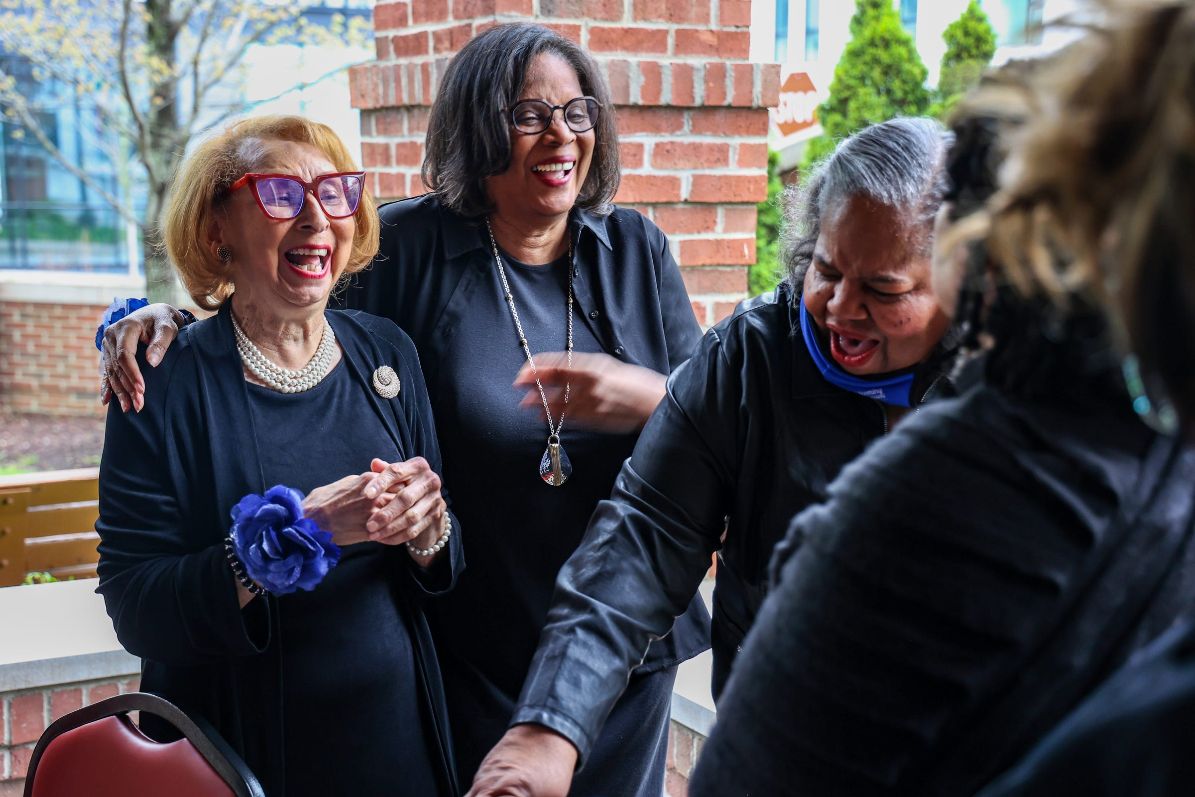 Elliottorian Business and Professional Women's Club President Jennifer Poole laughs with Scholarship co-chair Doreen Dudley after posing for a group photo at the Village of Brush Park Manor Paradise Valley in Detroit on April 29, 2021.  The Elliottorian Business and Professional Women's Club is the first club of Black business women in Detroit and Michigan and was founded in 1928.