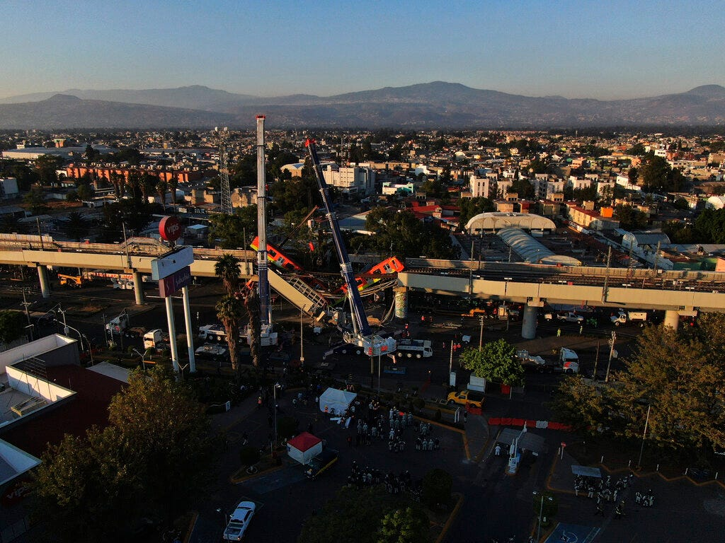 Mexico City metro overpass collapses onto road; 23 dead 1