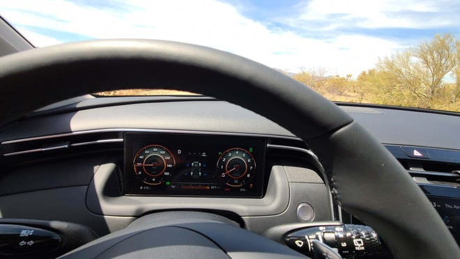 The 2022 Hyundai Tucson features an LCD instrument display that does not require a hood to shield it from the sun's glare. The design makes for a simplified cockpit.
