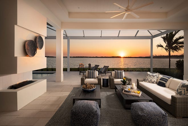 Residents don't have to go the beach for sunset over the water. From the lanai of the Santorini they can watch the sunset over the lake. The lanai overlooks the lake and features a spacious living, dining and outdoor kitchen area under roof and a pool under screen.