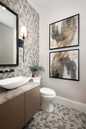 The designer used creative techniques in all the rooms including the bathrooms. Here she matched the floor tile on the wall and found art work in the same color patterns.