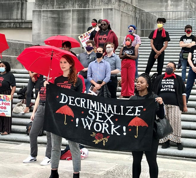 Supporters of a bill to decriminalize prostitution in Louisiana rall on the steps of the state Capitol on Tuesday, May 4, 2021.