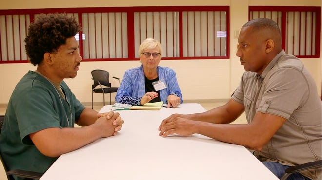 """Claude Motley, right, sits down with Nathan King, the teenager who shot him, as former state Supreme Court Justice Janine Geske looks on in a scene from """"When Claude Got Shot."""""""