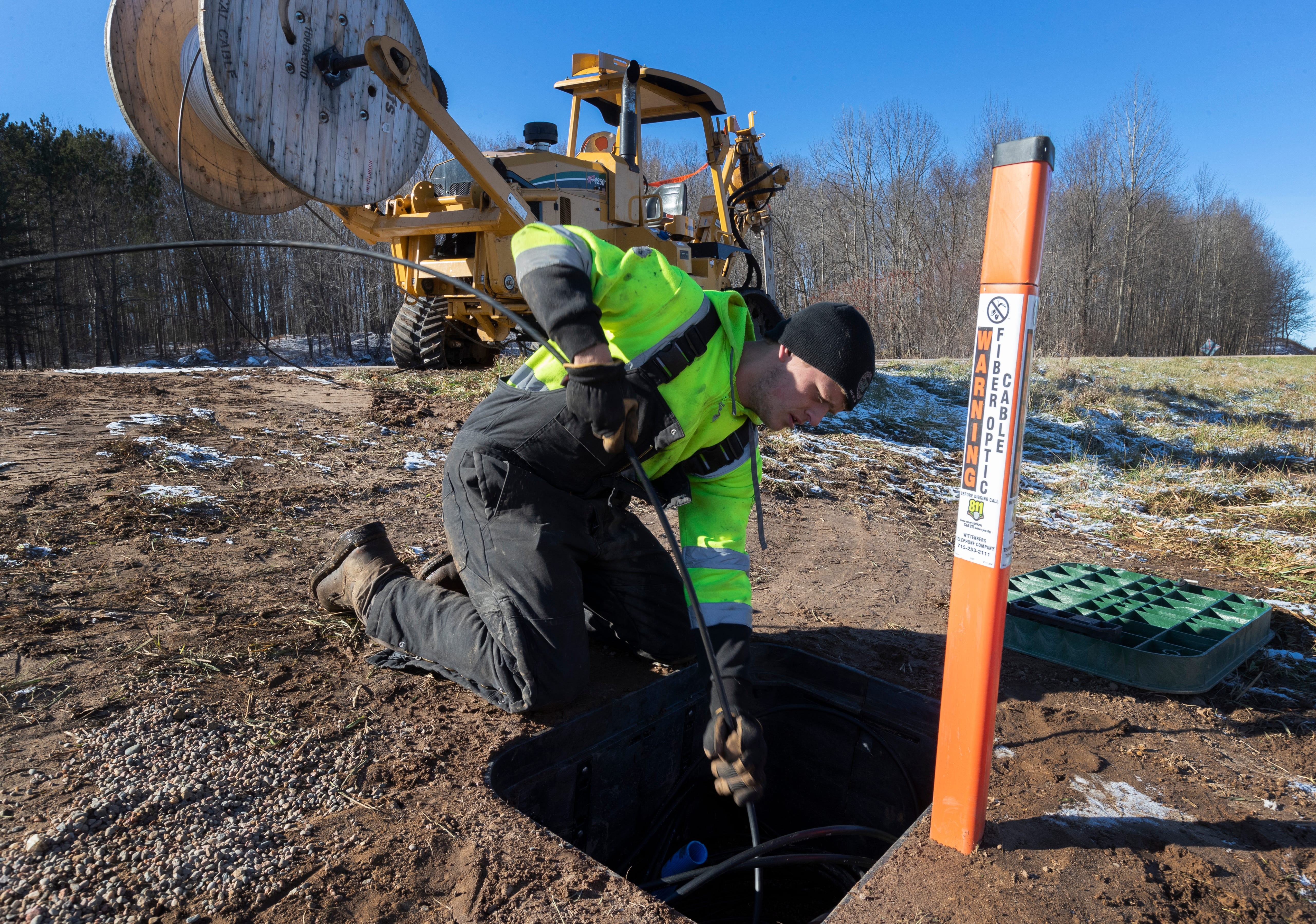 Kegan Hackbarth installs fiber-optic lines in the Shawano County village of Bowler. The Wittenberg Telephone Co. is installing hundreds of miles of fiber-optic cable in the area.