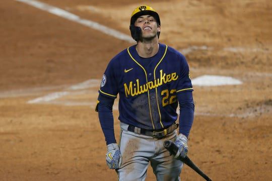 Christian Yelich strikes out in the third inning Monday night. Yelich returned to the lineup after missing three weeks.