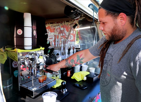 Javier Feliciano prepares 2 shots of espresso for a coffee drink from his portable business Wawa Expresso on Friday, April 30, 2021.