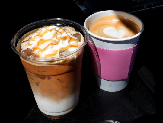 An iced caramel macchiato and a latte from Wawa Expresso on Friday, April 30, 2021.