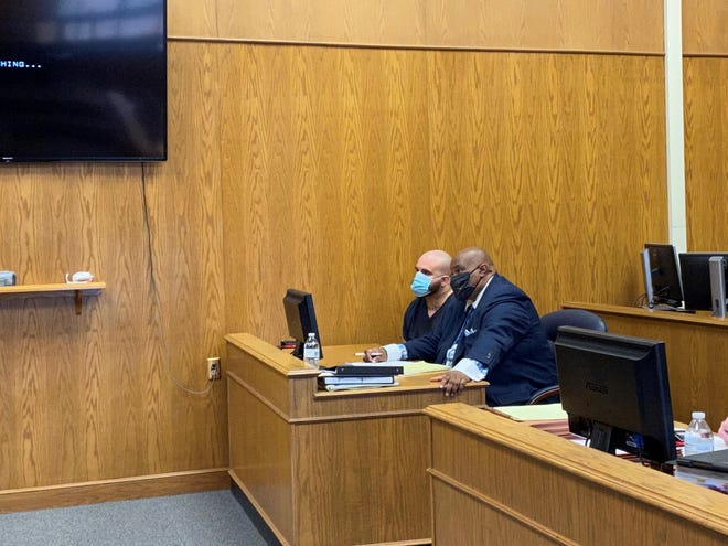Joseph Powell Jr. (left) sits beside his attorney, Gregory Carter, during a change of plea and sentencing hearing in Licking County Common Pleas Court on Tuesday, May 4, 2021. Powell was sentenced to 13 years in prison after he pleaded guilty to charges in a Pataskala home invasion and police chase from February 2021.