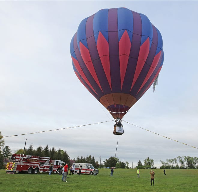The New Jersey Lottery Festival of Ballooning thanked frontline workers like first responders and teachers with a tethered balloon ride at Solberg Airport in Readington, NJ on May 4, 2021, the site of the balloon festival that returns in July.
