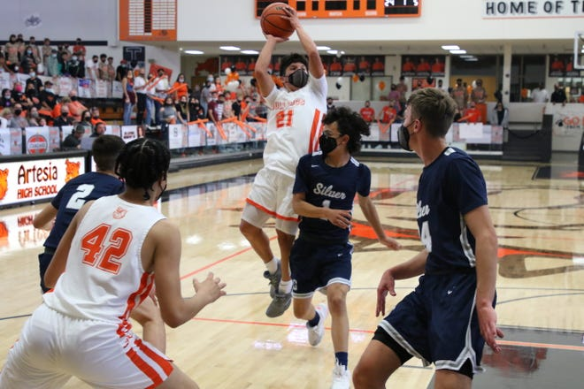 Artesia's Nick Sanchez drives to the basket during the 4A Boys Basketball State Championship quarterfinals May 4, 2021 in Artesia. Sanchez was one of three Bulldogs to score in double figures with 11 points. Artesia won, 76-58 and advances to the semifinals on Thursday.