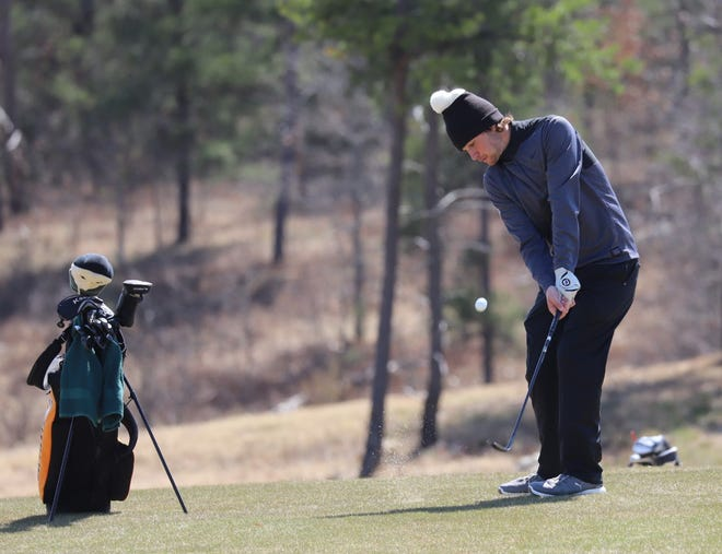 Northville golfer Griffin Blackman participates in an event at The Loop at Forest Dunes.