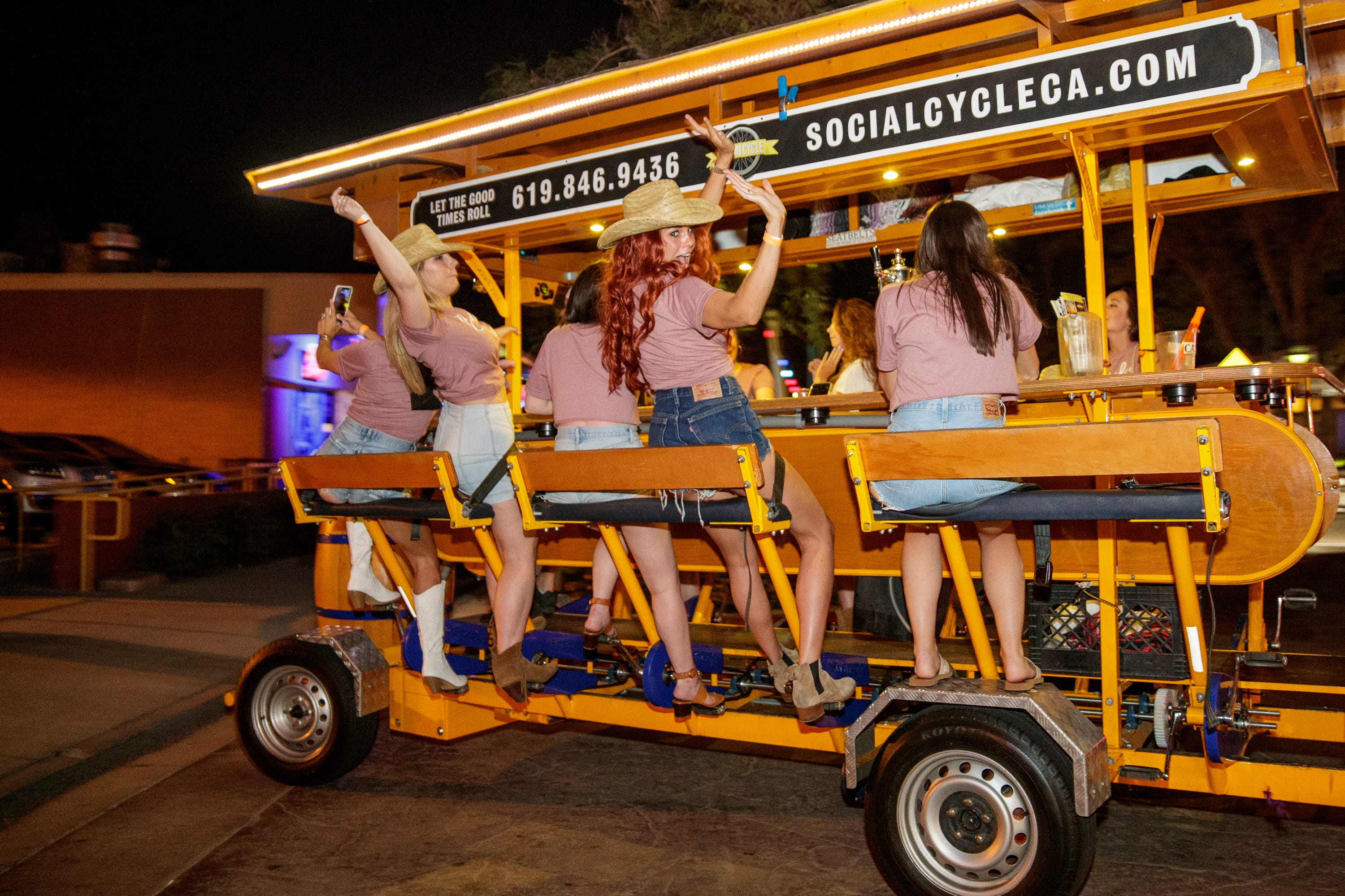 A group of women arrive on Arenas Road via bar bike in Palm Springs, Calif., on Friday, April 30, 2021.