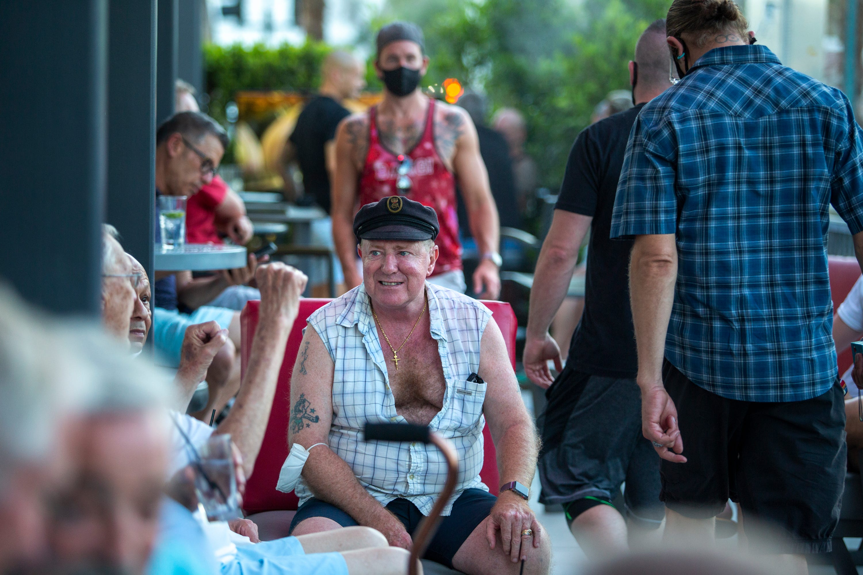 Tony Lawrence, center, socializes at Quadz Palm Springs on Arenas Road in Palm Springs, Calif., on Friday, April 30, 2021.