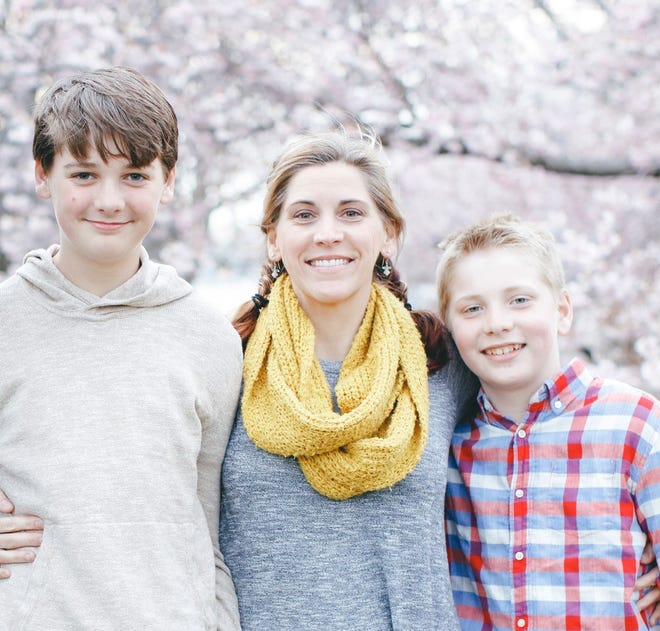 Jeanette Wittmeyer of Brighton with her sons Preston, 15, and Owen, 12.