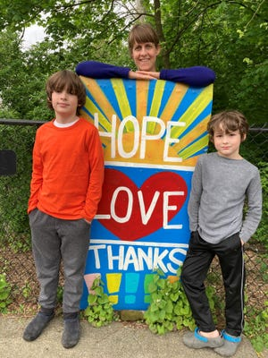 Kate Clarke of Newburgh and her boys Carter, 10, and Jack, 8.