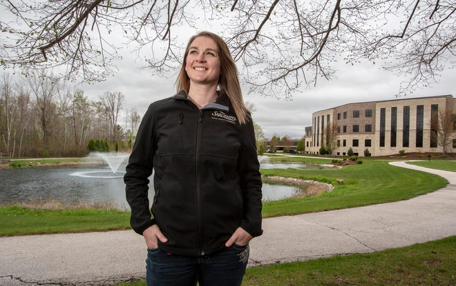 Sargento's Kirstin Feldmann, a quality systems technologist seen posing at the company's Plymouth campus on Tuesday, is optimistic about her future as the company supports employees with mental health issues.