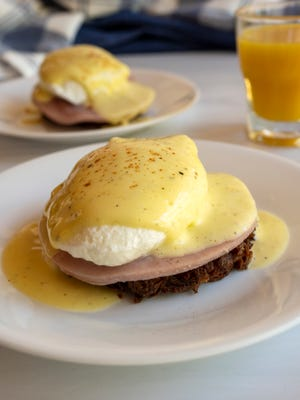 Eggs Benedict on hash brown rounds, which are similar to potato latkes. They consist of russet potatoes, all-purpose flour, egg, salt and pepper.