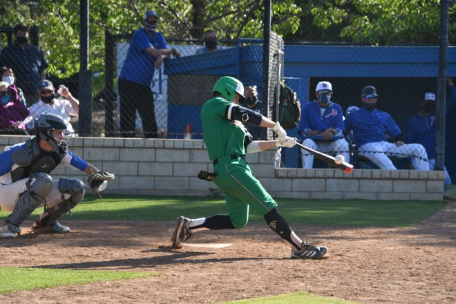 Roc Riggio connects for a two-run homer during Thousand Oaks High's 7-1 victory over Westlake on Monday, May 3, 2021. The Lancers improved to 16-0 overall and 8-0 in the Marmonte League with their 24th straight victory.