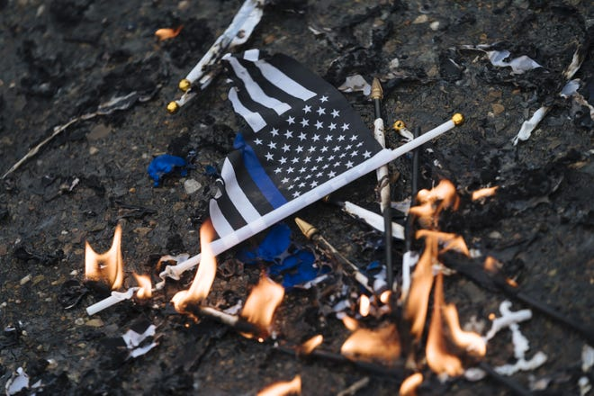 Demonstrators burned thin-blue-line flags outside Sacramento Police Department  on March 2, 2019, in Sacramento, California.