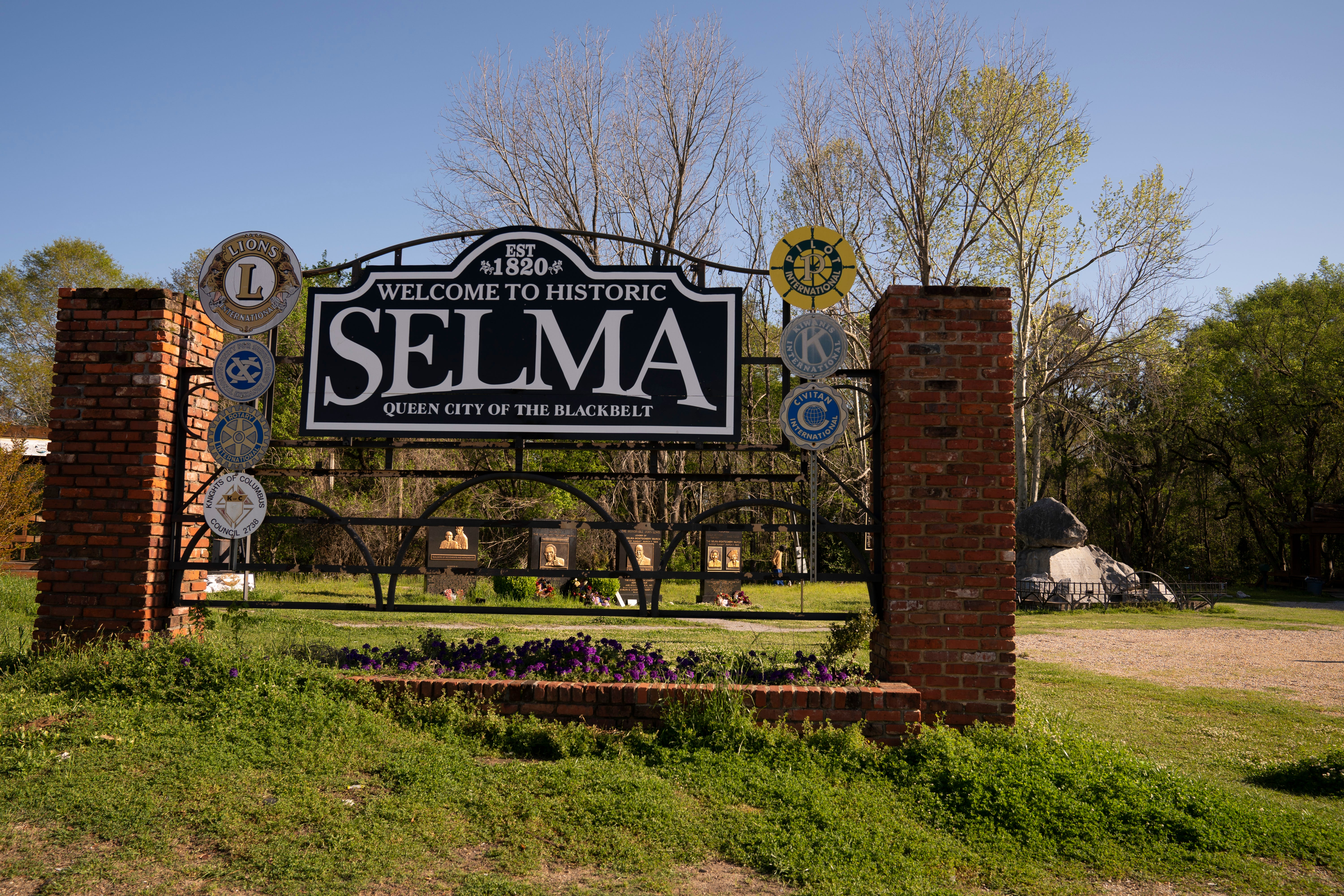 A sign welcoming visitors to Selma, Alabama sits in the Civil Rights Memorial Park near the foot of the Edmund Pettus Bridge.
