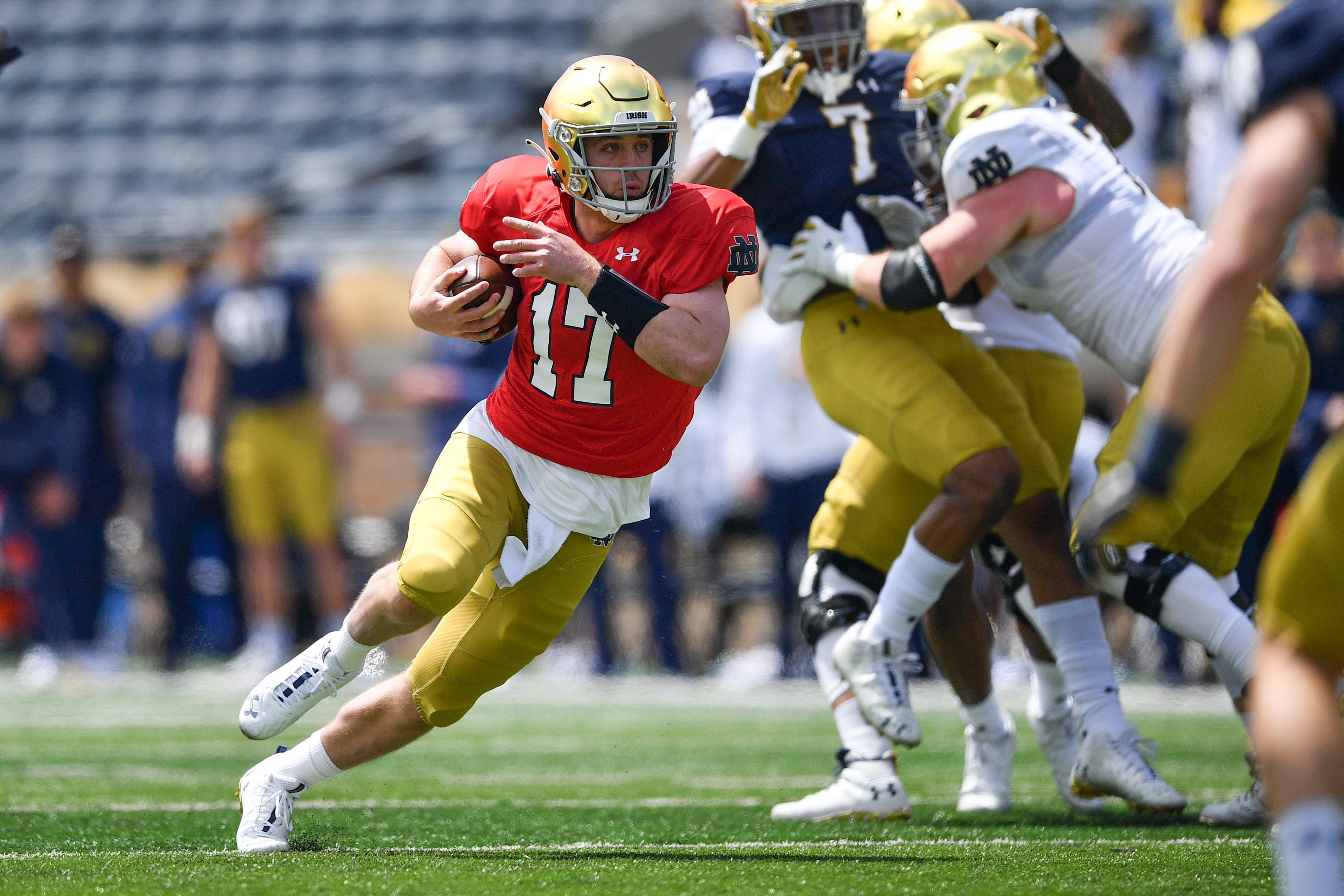 Notre Dame's Jack Coan, who transferred from Wisconsin, is expected to contend for the starting job.