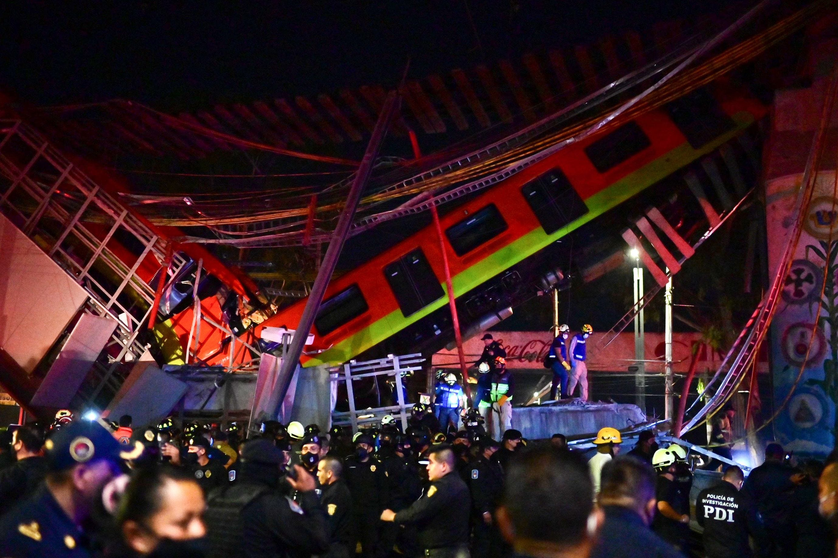 Mexico City metro overpass collapses onto road, killing at least 13 and injuring 70, authorities say