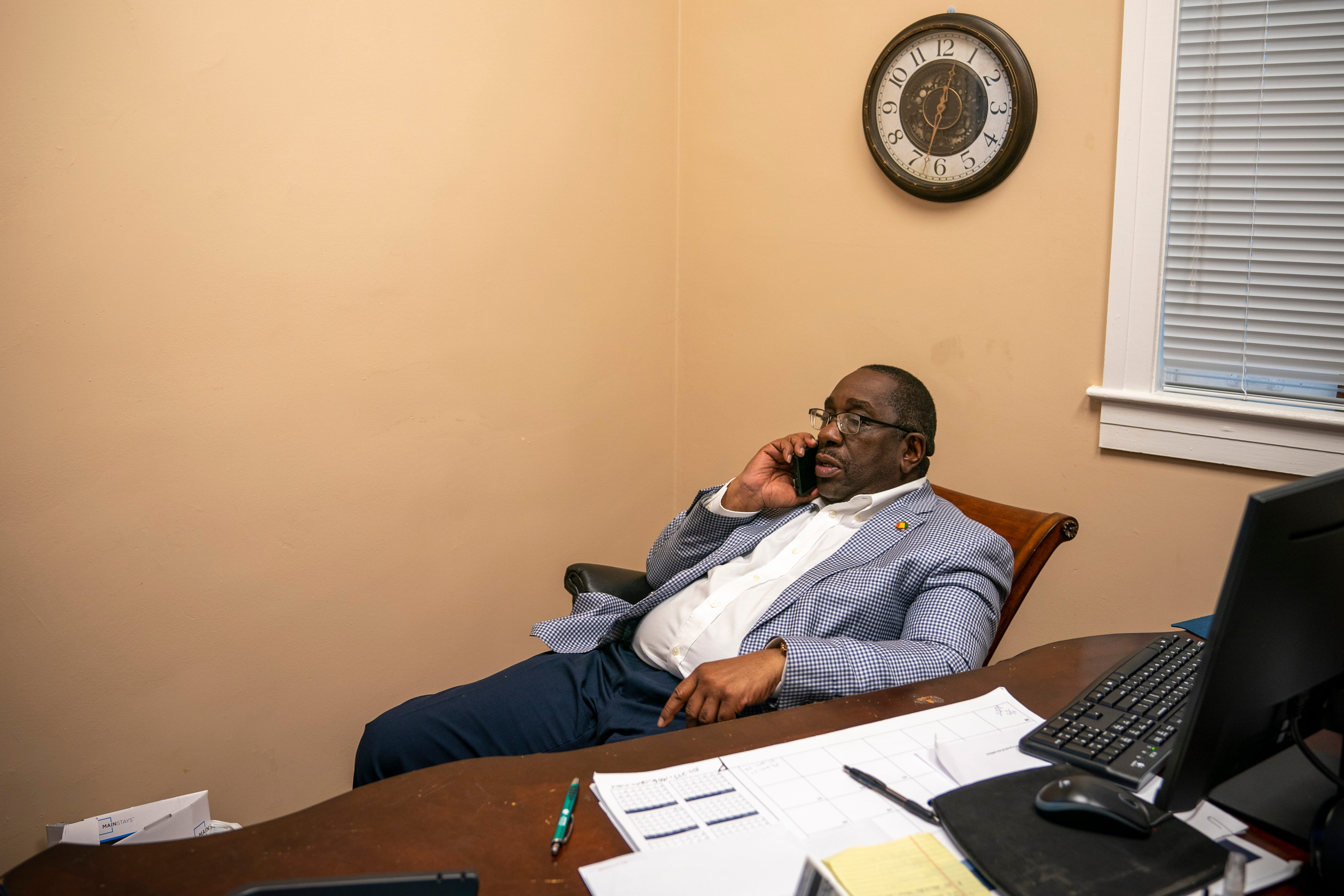 Perry County Commissioner Albert Turner Jr. talks on the phone in his office at the Perry County Courthouse, March 31, 2021. Turner's father, Albert Turner, was a civil rights activist who helped lead the voting rights march from Selma to Montgomery in 1965 after Jimmie Lee Jackson's death.