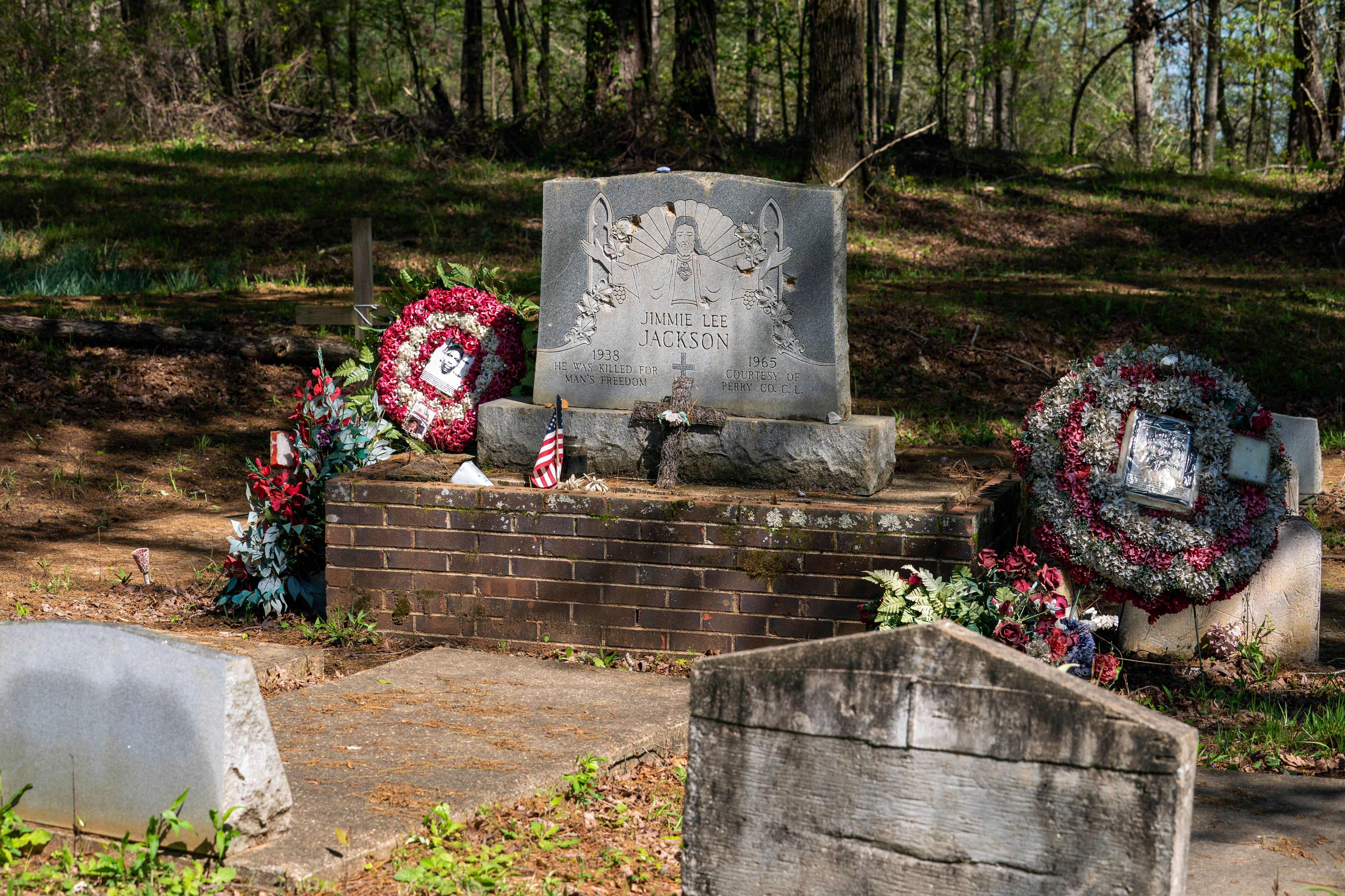 The gravesite of Jimmie Lee Jackson in Marion, Alabama is adorned with tributes to his fateful death.