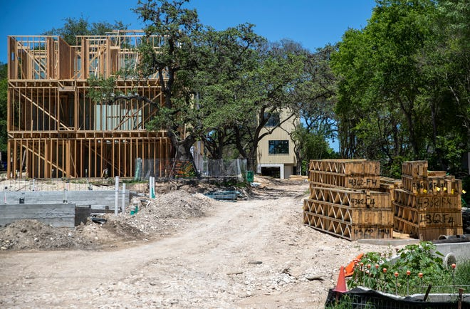 A new townhome project is under construction on West Alpine Road in Austin. Builders started work on a record number of new homes in the Austin area in the first quarter, but a supply-and-demand gap remains.