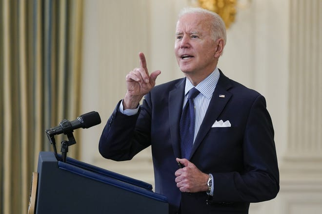 President Joe Biden takes questions from reporters as he speaks about the COVID-19 vaccination program at the White House on Tuesday.