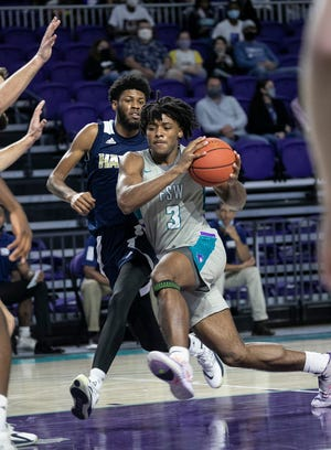 Kario Oquendo of Florida SouthWestern drives to the basket against Hillsborough in men's basketball on Jan. 20, 2021, at Suncoast Credit Union Arena in Fort Myers.