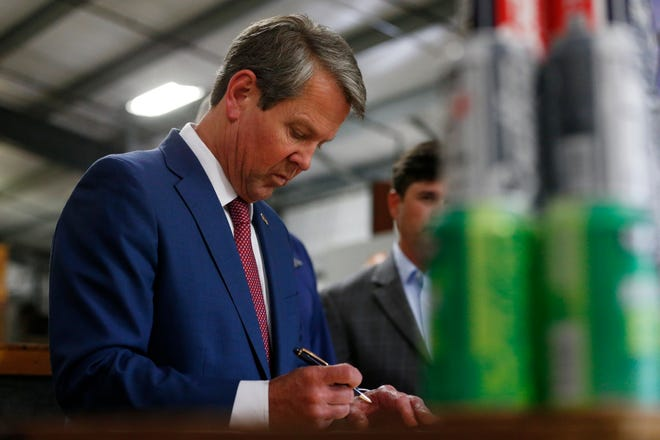 Gov. Brian Kemp signed the legislation Wednesday at Southern Brewing Co. in Athens.